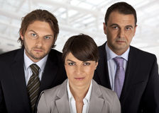 Business team of three. Female infront, two males behind stock photo