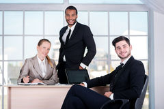 Business team. Three businessman sitting at the table while thre Stock Photos