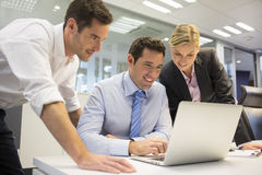 A business team of three in office and planning work Royalty Free Stock Image