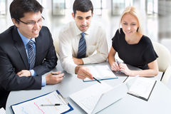 A business team. Of three plan work in office Royalty Free Stock Photos