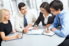 A business team. Of three plan work in office Stock Photo