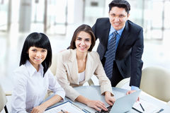 A business team. Of three plan work in office Royalty Free Stock Images