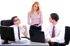 Business. A business team of three plan work in office. Isolated on a white background Royalty Free Stock Image