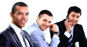 A business team of three sitting in office Stock Images