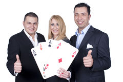 Business Team threesome. A business team of three person with four aces Royalty Free Stock Images