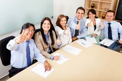 Business team with thumbs up Stock Image