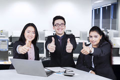 Business team with thumbs-up in office Stock Images