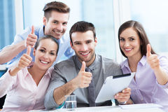 Business team with thumbs up Stock Photos