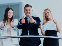 Business team with the thumbs up in a stairs. Business team with the thumbs up in a stairs Stock Photo