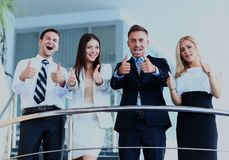 Business team with the thumbs up in a stairs. Business team with the thumbs up in a stairs Stock Image