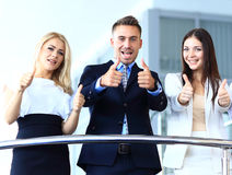 Business team with the thumbs. Up in a stairs Royalty Free Stock Image