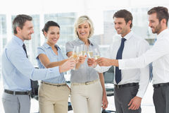 Business team toasting with champagne in office Stock Photos