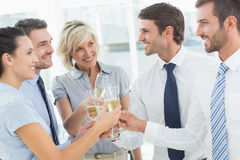 Business team toasting with champagne in office Royalty Free Stock Photo