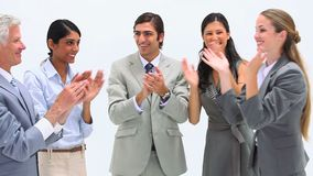 Business team together. Applauding against a white background stock footage