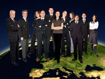 Business team on top of the world Stock Photo