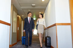 Business team with travel bags at hotel corridor Royalty Free Stock Image
