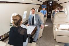 Business team traveling in corporate jet Royalty Free Stock Photography