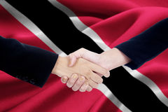 Business team with Trinidad and Tobago flag Stock Images