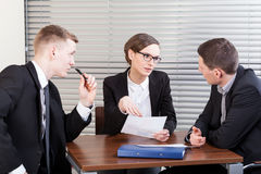 Business team trying to resolve problem. At work Royalty Free Stock Images