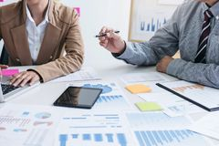 Business team two colleagues discussing new plan financial graph Royalty Free Stock Images