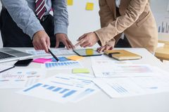 Business team two colleagues discussing new plan financial graph Royalty Free Stock Photos