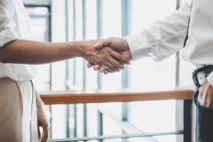 Business team two executive shaking hands after a meeting and conference to sign agreement and become partner in the office, stock image