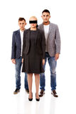 Business team-two man and blindfolded woman Royalty Free Stock Image