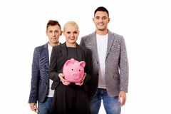 Business team-two men and woman holding piggybank. Business team-two men and women holding piggybank Stock Image