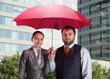Business team under umbrella Stock Image