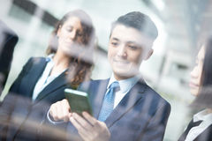 Business team use smart phone Royalty Free Stock Photos