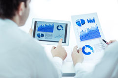 Business team using digital tablet analyzes the marketing report Stock Photo