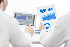 Business team using digital tablet analyzes the marketing report Stock Photography