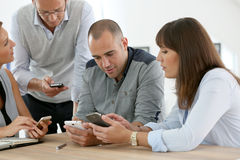 Business team using electronical devices. Business group meeting with smartphones Royalty Free Stock Image