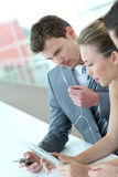 Business team using electronical devices. Business team working with electronic tablet Royalty Free Stock Photo