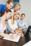Business team using internet connection with laptop computer Stock Photo
