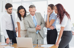 Business team using a laptop Royalty Free Stock Photo