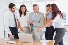 Business team using a laptop Stock Photos