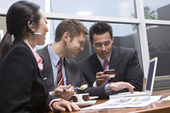 Business Team Using Laptop During Their Coffee Break Royalty Free Stock Photos