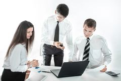 Business team using a laptop in the workplace. Business concept stock images