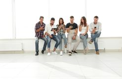 Business team using modern gadgets. While sitting in the lobby of the office Royalty Free Stock Photography
