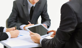 Business team using tablet computer to work. Close-up of a modern business team using tablet computer to work Stock Photo