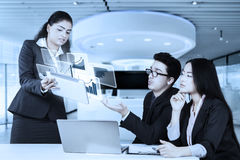 Business team using tablet Stock Photo