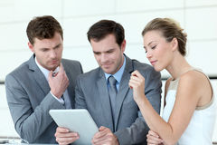 Business team using tablet in meeting royalty free stock photos