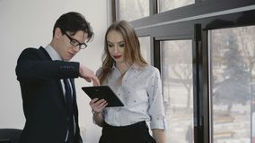 Business team using tablet in the office in 4K.  stock footage