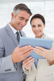 Business team using a tablet pc Stock Photos