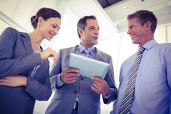 Business team using tablet together Royalty Free Stock Images