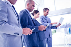 Business team using their media devices Royalty Free Stock Photos