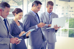 Business team using their media devices Royalty Free Stock Images