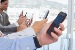 Business team using their mobile phone Royalty Free Stock Images