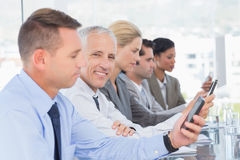 Business team using their mobile phone Stock Image